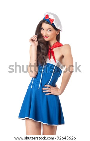 Attractive young sailor woman smiling and looking at camera. High resolution image taken in studio. Isolated on pure white background with copy space for your ad. - stock photo