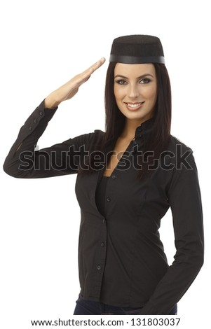 Attractive young stewardess saluting. - stock photo