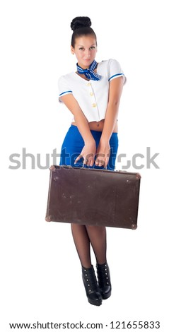 Attractive young stewardess with old suitcase, isolated over white background - stock photo