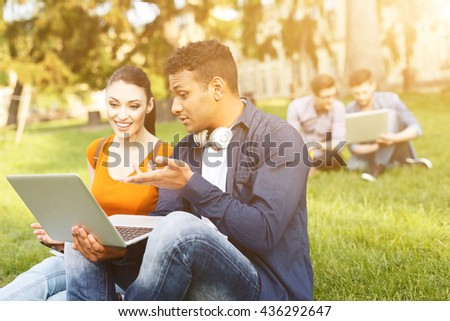 Attractive young students are relaxing near university - stock photo