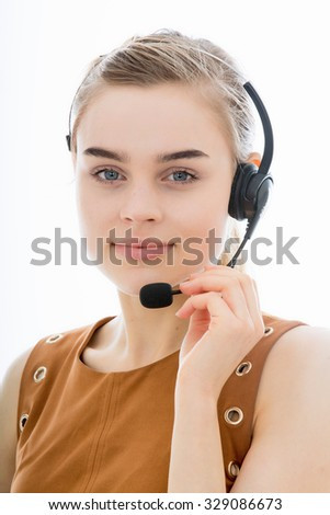 Attractive Young Telephonist at Work Taking Calls or Marketing Products Isolated Against a Plain White Background - stock photo