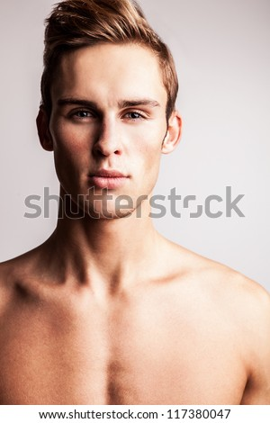Attractive young undressed man model. - stock photo