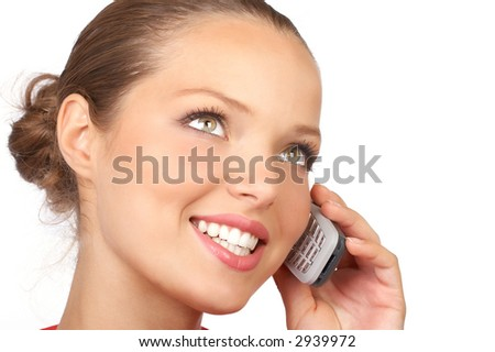 attractive young woman calling by cellular phone. Isolated over white. - stock photo