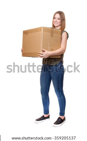 Attractive young woman carrying moving boxes. - stock photo