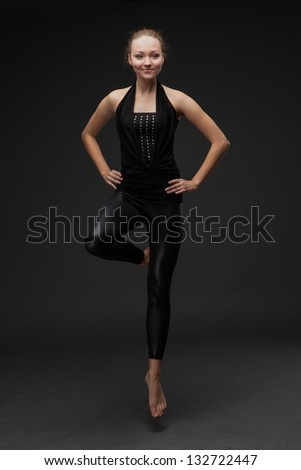 attractive young woman dancing - stock photo