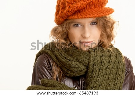 Attractive young woman dressed up warm for winter, wearing hat, gloves, scarf and coat, freezing.? - stock photo