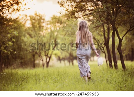 Attractive young woman enjoying her time outside in park. - stock photo