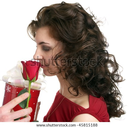Attractive young woman get a gift with red rose isolated on the white background - stock photo