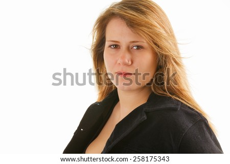 Attractive young woman giving a serious expression - stock photo