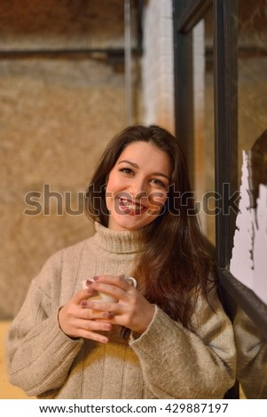 attractive young woman having coffee in the window - stock photo