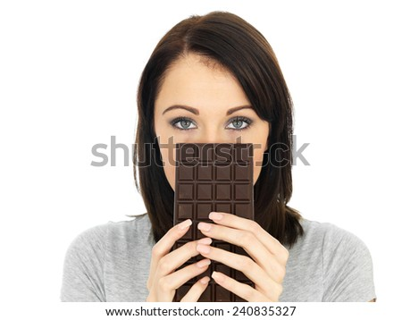 Attractive Young Woman Hiding Behind a Chocolate Bar - stock photo