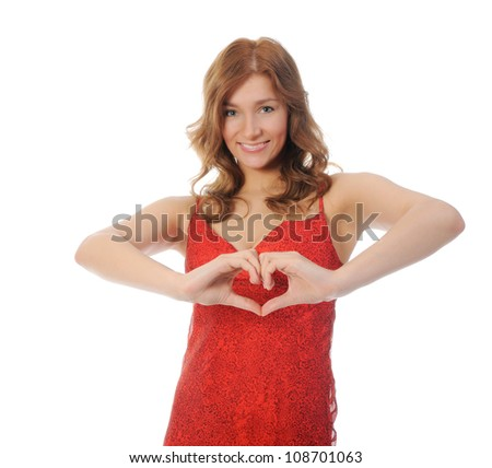 Attractive young woman holding a heart. isolated on white background. - stock photo
