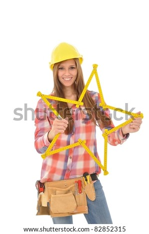 Attractive young woman holding a yellow star of a ruler - stock photo