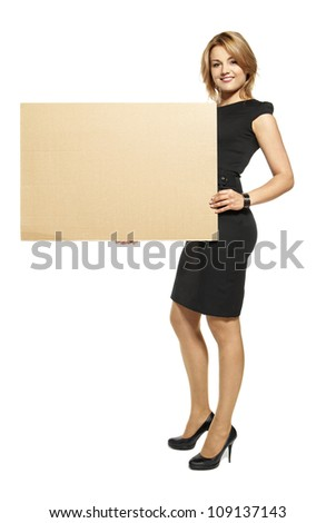 Attractive  Young Woman Holding Up a Blank Paperboard. Studio shot of woman isolated on white background. - stock photo