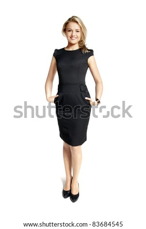 Attractive young woman in a black dress smiling and looking at camera. - stock photo