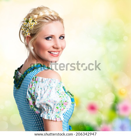 attractive young woman in a traditional dirndl - stock photo