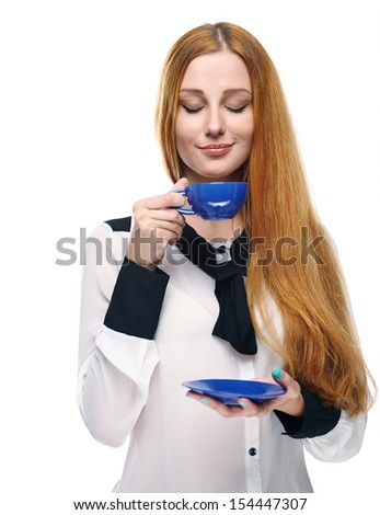 Attractive young woman in a white blouse. Holds a blue cup and saucer. Isolated on white background - stock photo