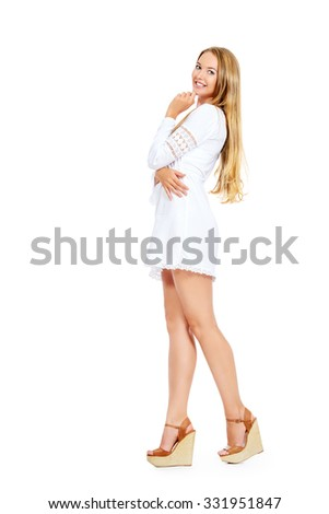 Attractive young woman in a white summer dress and sandals. Isolated over white. - stock photo
