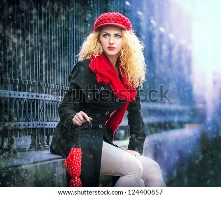 attractive young woman in a winter fashion shot.Winter wild woman on snow.Winter Girl with beautiful make up, and snow flake.Portrait of attractive woman - stock photo