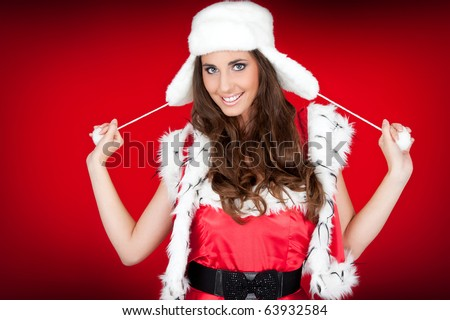 attractive young woman in santa costume posing - stock photo