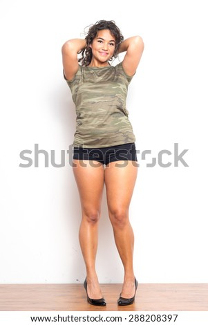 Attractive young woman in sport tee and shorts - stock photo
