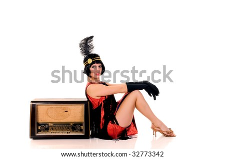Attractive young woman in vintage looking Charleston dress.    Studio shot, white background. - stock photo