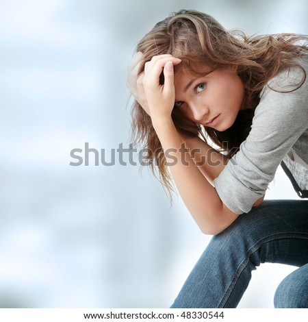 Attractive young woman is disappointed - stock photo