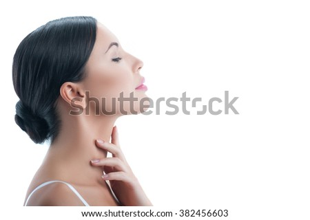 Attractive young woman is treating her body - stock photo