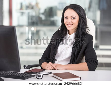 Attractive young woman is working in a call center. - stock photo