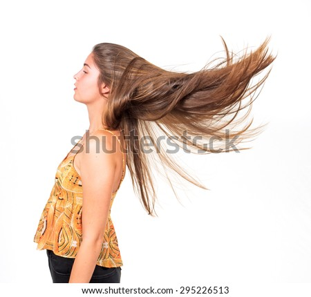 attractive young woman lets her long hair fly - stock photo