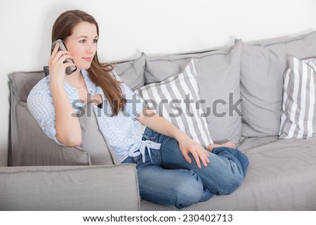 Attractive young woman making a phone call - stock photo