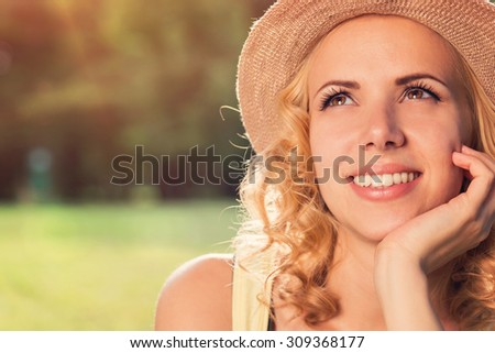 Attractive young woman outside in summer nature - stock photo