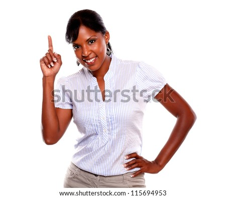 Attractive young woman pointing up while is looking at you against white background - stock photo