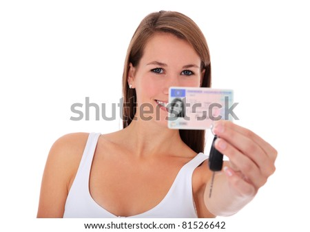Attractive young woman showing her european driver license. All on white background. - stock photo
