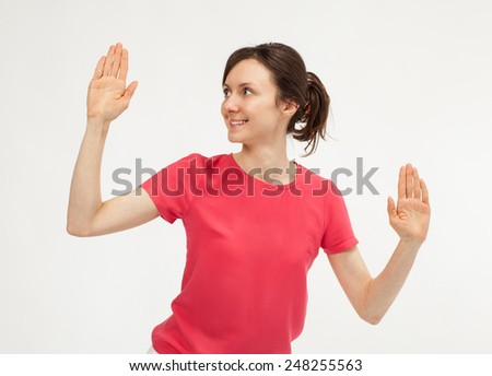 Attractive young woman showing palms - closeup portrait - stock photo
