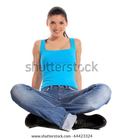 Attractive young woman sitting on the floor. All on white background. - stock photo