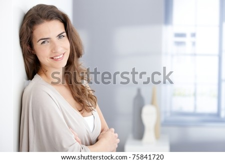 Attractive young woman smiling happily at home.? - stock photo
