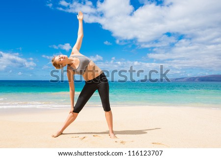 Attractive Young Woman Stretching at the Beach���  - stock photo