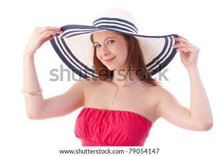 Attractive young woman wearing elegant dress and hat, smiling.? - stock photo