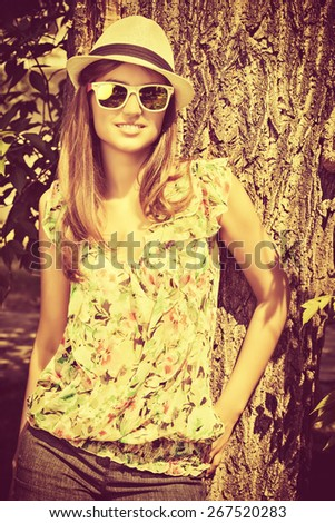Attractive young woman with beautiful smile outdoors. Fashion. Summer day. - stock photo