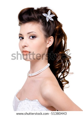 Attractive young woman with beautiful wedding hairstyle - isolated on white - stock photo