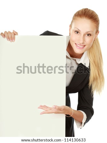 attractive young woman with blank billboard, white background - stock photo