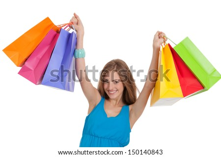 attractive young woman with colorful shopping bags isolated on white background - stock photo