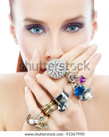 Attractive young woman with diamond on the hands looking to the camera on the white background - stock photo