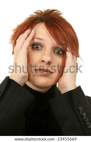 Attractive young woman with stressed, angry or worried expression. - stock photo