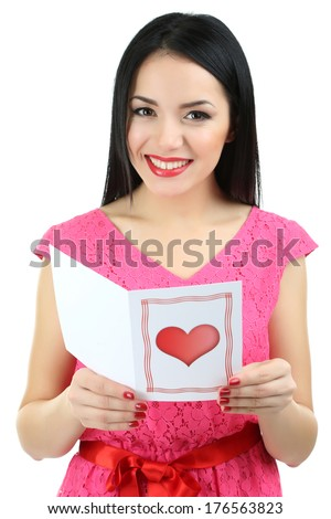 Attractive young woman with Valentine card isolated on white - stock photo