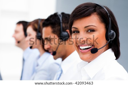 Attractive young woman working in a call center with his colleagues - stock photo