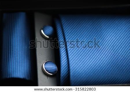 attributes of men's fashion style. necktie, cufflinks, scarf - stock photo