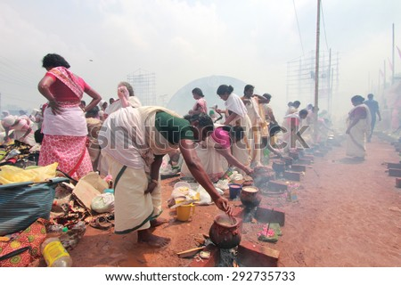 ATTUKAL, INDIA - MAR 7: Unidentified devotees take part in the 'Pongala' ritual on March 7, 2012 in Attukal,Kerala,India.The event is in Guinness records as the largest gathering of women in the world - stock photo