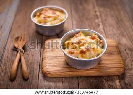 Au Gratin cheese  on the wood table. - stock photo